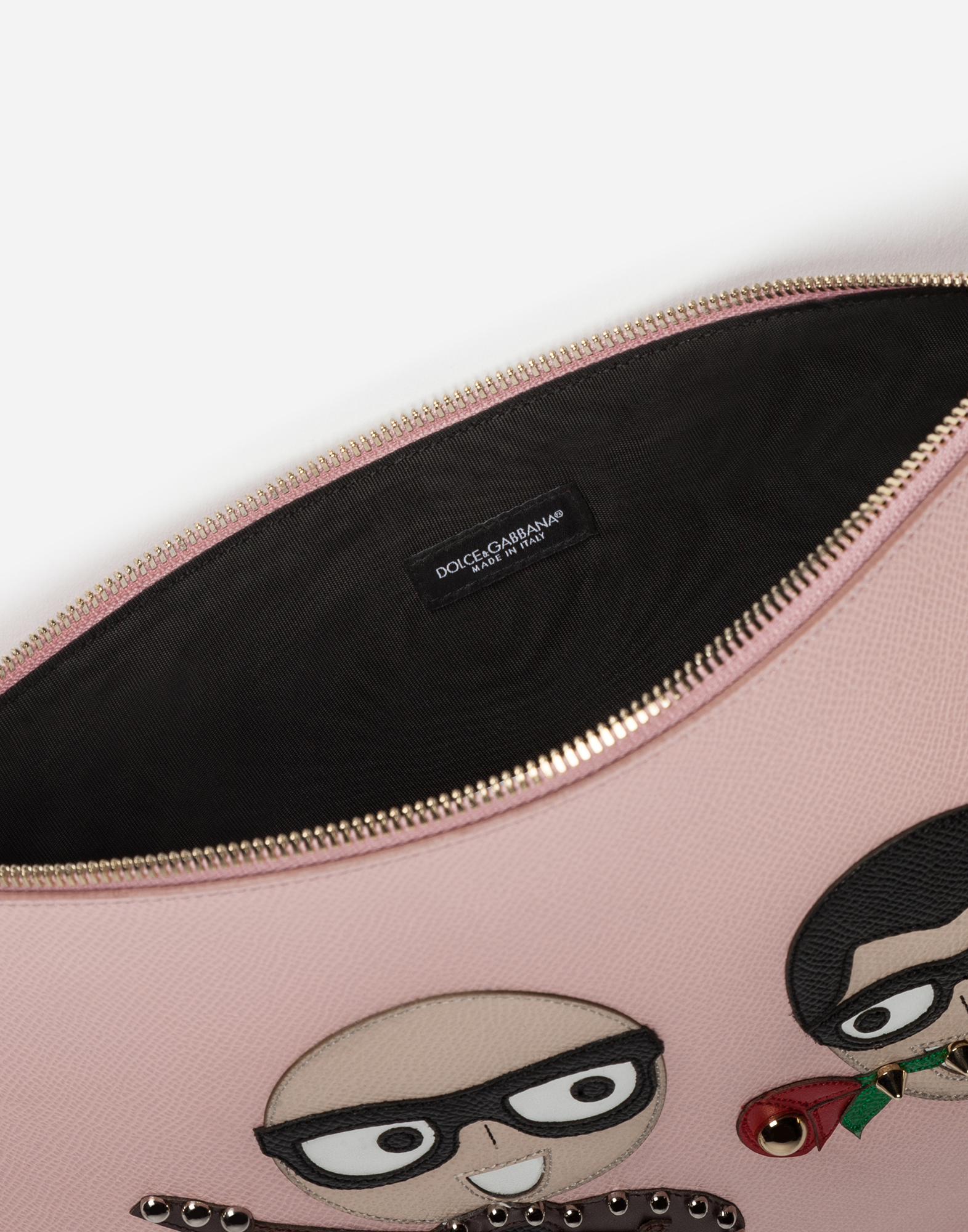 CLUTCH IN PRINTED DAUPHINE CALFSKIN WITH DESIGNERS' PATCHES