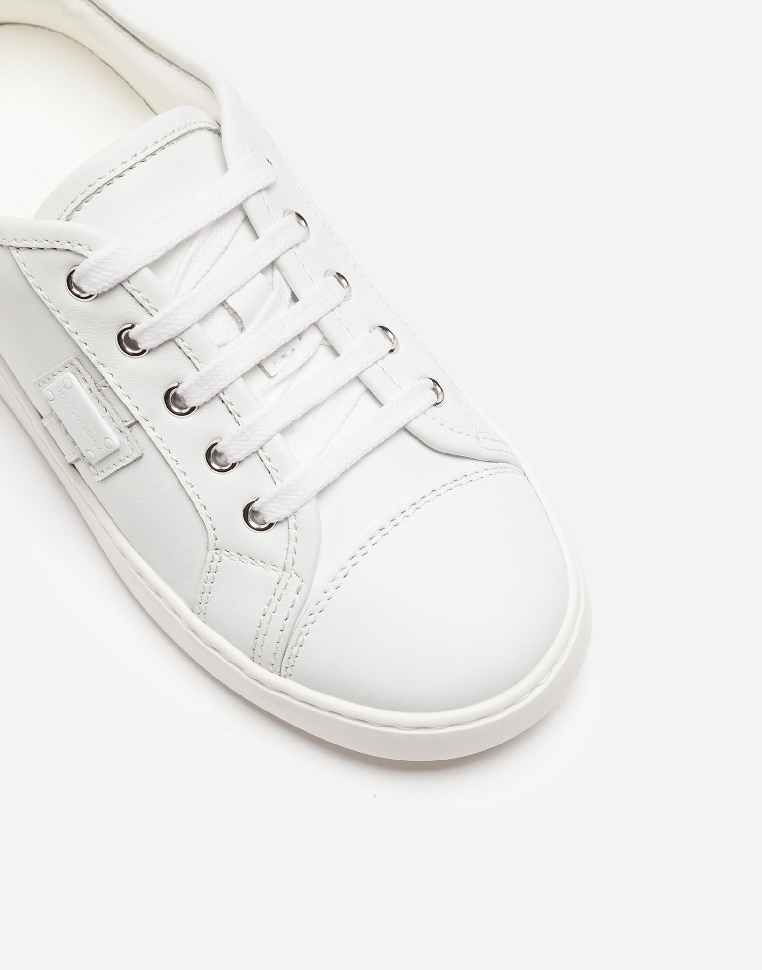 LEATHER SNEAKERS WITH PLAQUE